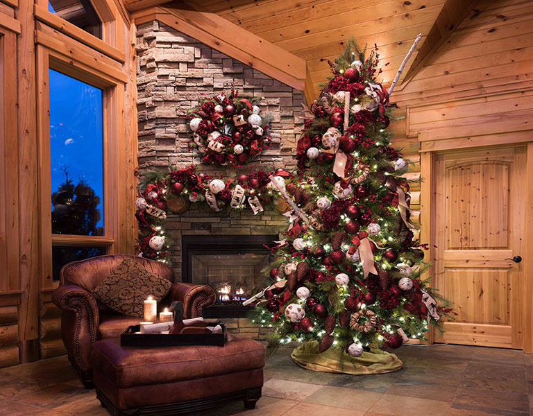 Photograph of a tree and fireplace decorated for Christmas